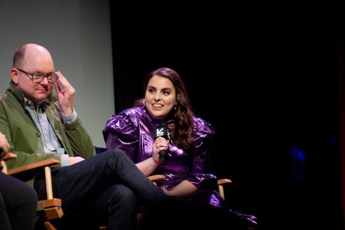 Beanie Feldstein wears the first look that makes Walsh look like her: a purple Batsheva dress for South by Southwest.