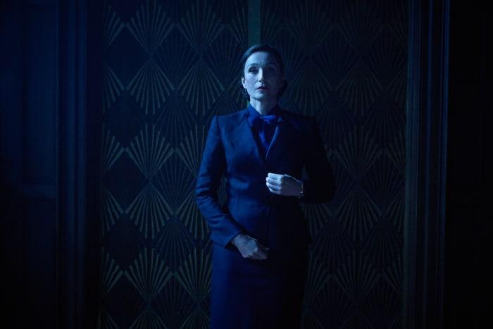 Mrs. Danvers (Kristen Scott Thomas) guards Rebecca's room.