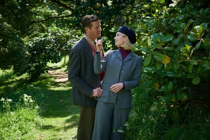 Maxim in his country clothes and Mrs. de Winter in her very Marlene Dietrich pantsuit.
