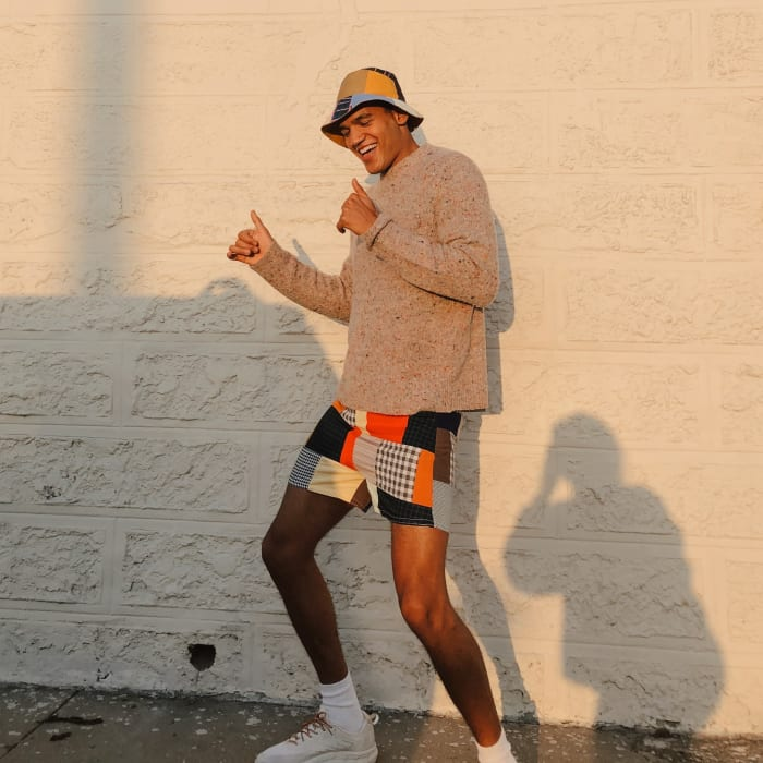 Oddli's Cartwheel Shorts, paired with its Bucket Hat, also unisex.