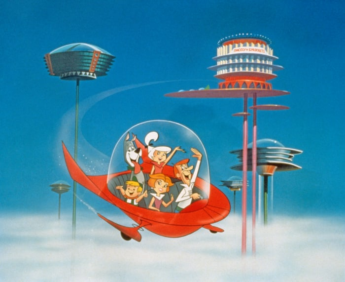 "The Jetsons wave as they fly past neighbors in their spaceship in silence ""The Jetsons,"" around 1962."