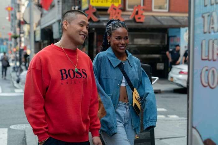 Taylor Takahashi as Alfred 'Boogie' Chin and Taylour Paige as Eleanor in 'Boogie,' costume design by Vera Chow.