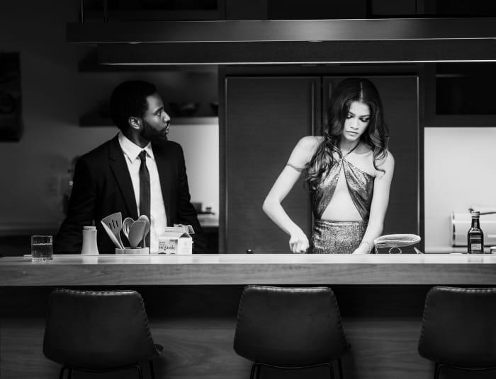 Malcolm (John David Washington) not helping Marie (Zendaya) in the kitchen.