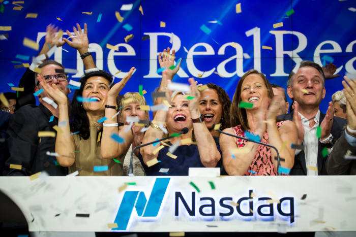 The RealReal Inc. executives applaud while ringing the opening bell during the company's IPO at the Nasdaq MarketSite in New York City in June 2019.