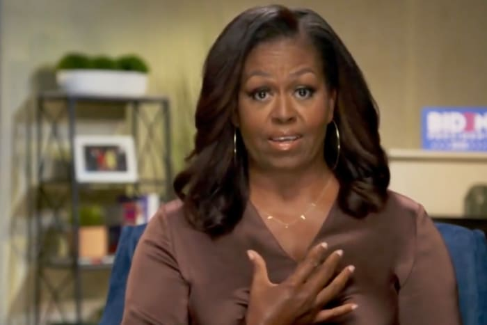"""Michelle Obama wearing a necklace that reads """"VOTE"""" by By Chari at the 2020 Democratic Convention; the brand would then sell a similar style in partnership with her voting nonprofit, When We All Vote."""