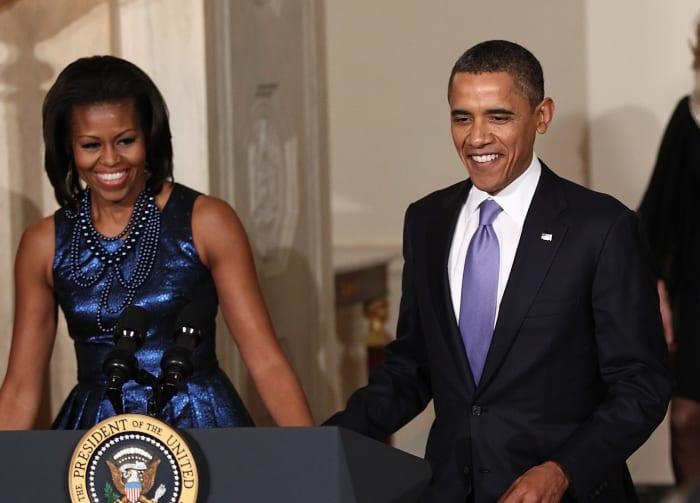 Michelle Obama, wearing Rodarte, with former president Barack Obama at a Hanukkah reception in 2011.
