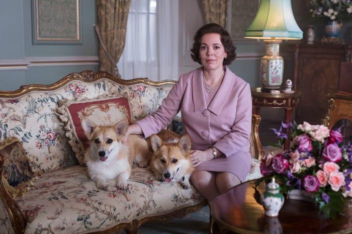 Queen Elizabeth II (Olivia Colman) and her corgis.