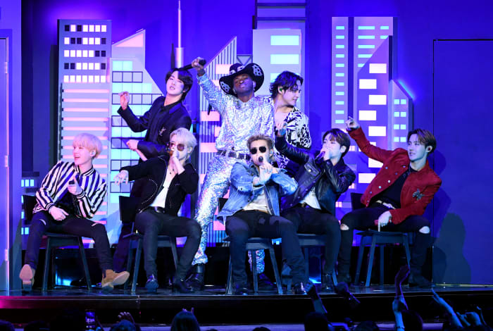 Lil Nas X and BTS perform on stage during the 62nd Annual GRAMMY Awards