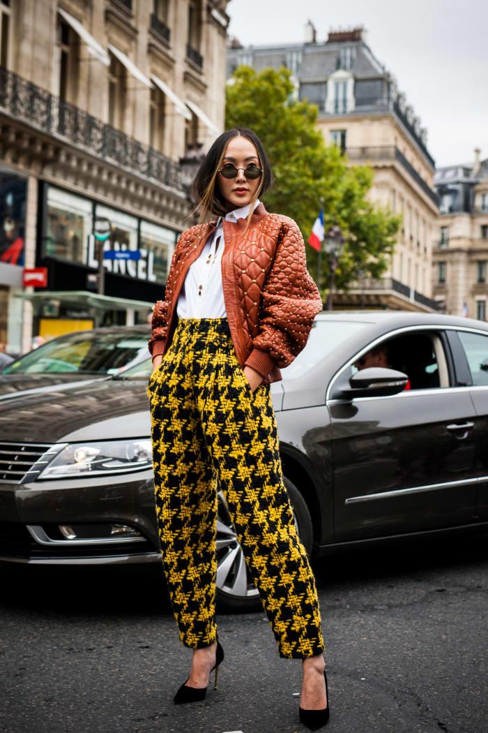 Lim at Paris Fashion Week in 2017, wearing Balmain.