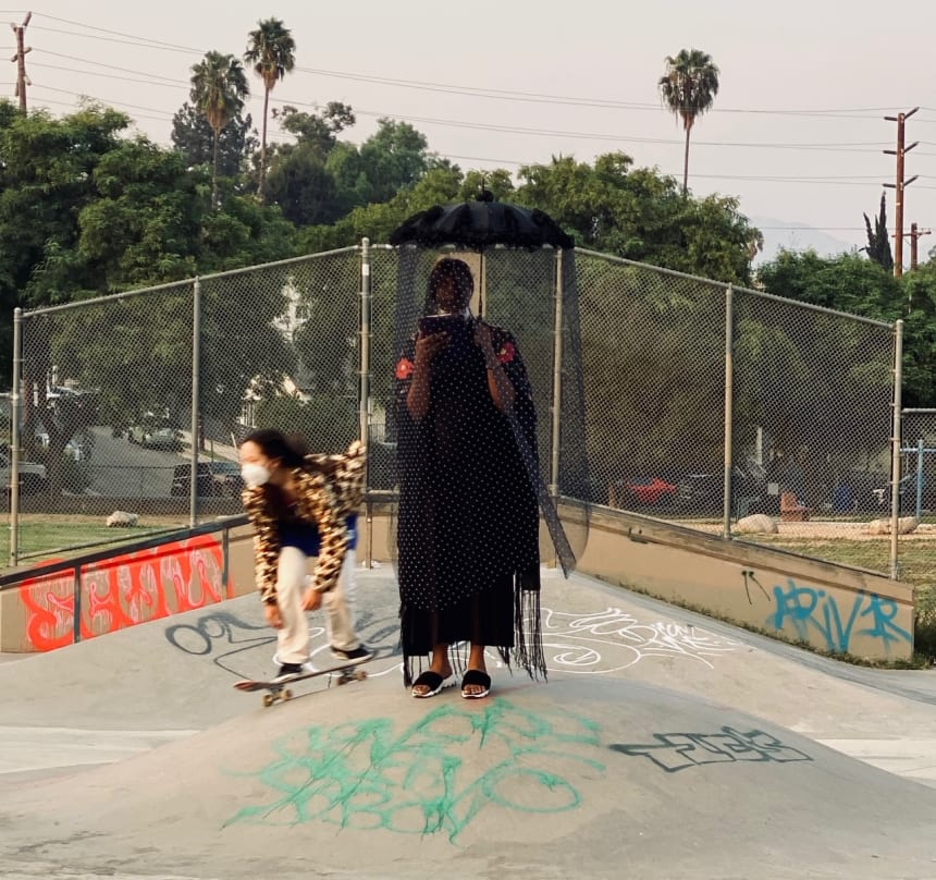 An opera singer and skateboarder at Imitation of Christ's Los Angeles show.
