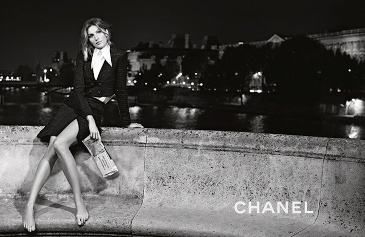 Surfboard swapped for newspaper. Photo: Chanel.