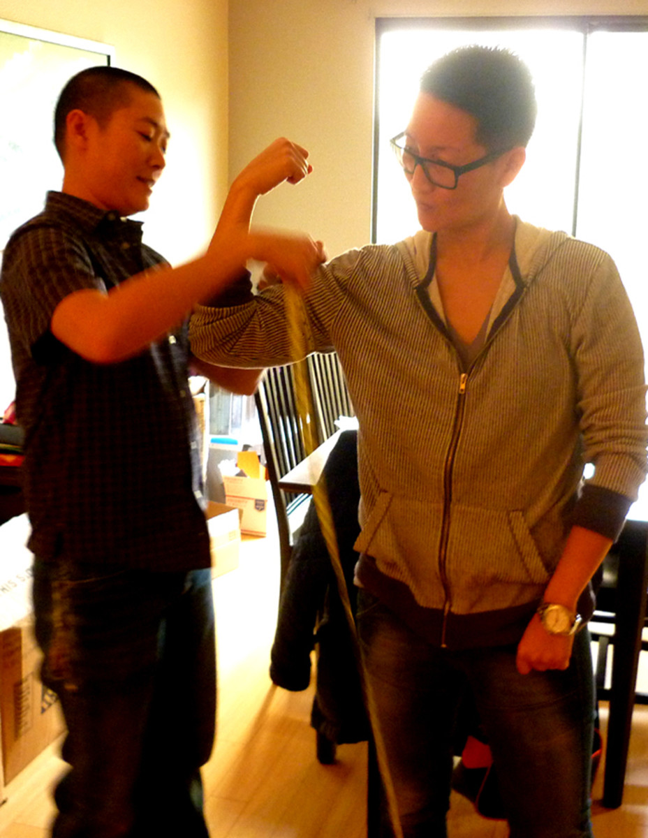 Sharpe Suiting founder and CEO Leon Wu takes measurements during a consultation. Photo: Sharpe Suiting