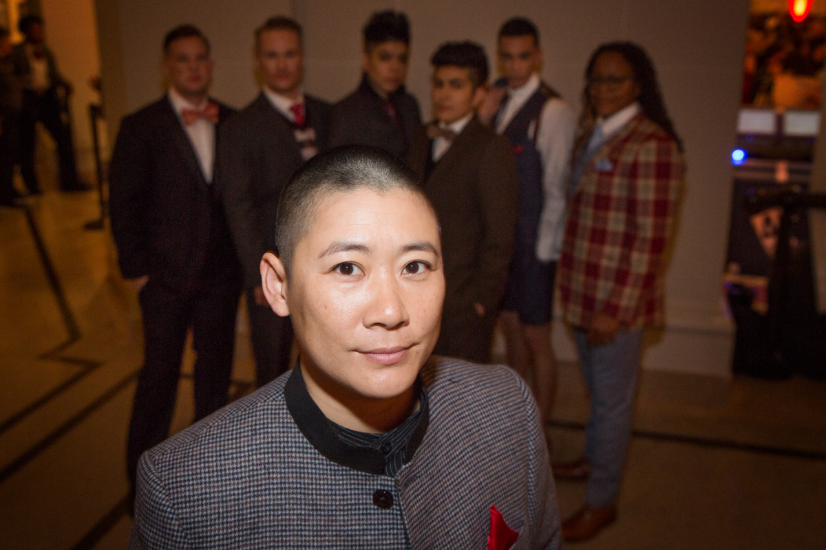 Sharpe Suiting founder Leon Wu stand in front of the models at the dapperQ (un)Heeled Fashion Show in Brooklyn on December 6th. Photo: Courtesy Sharpe Suiting