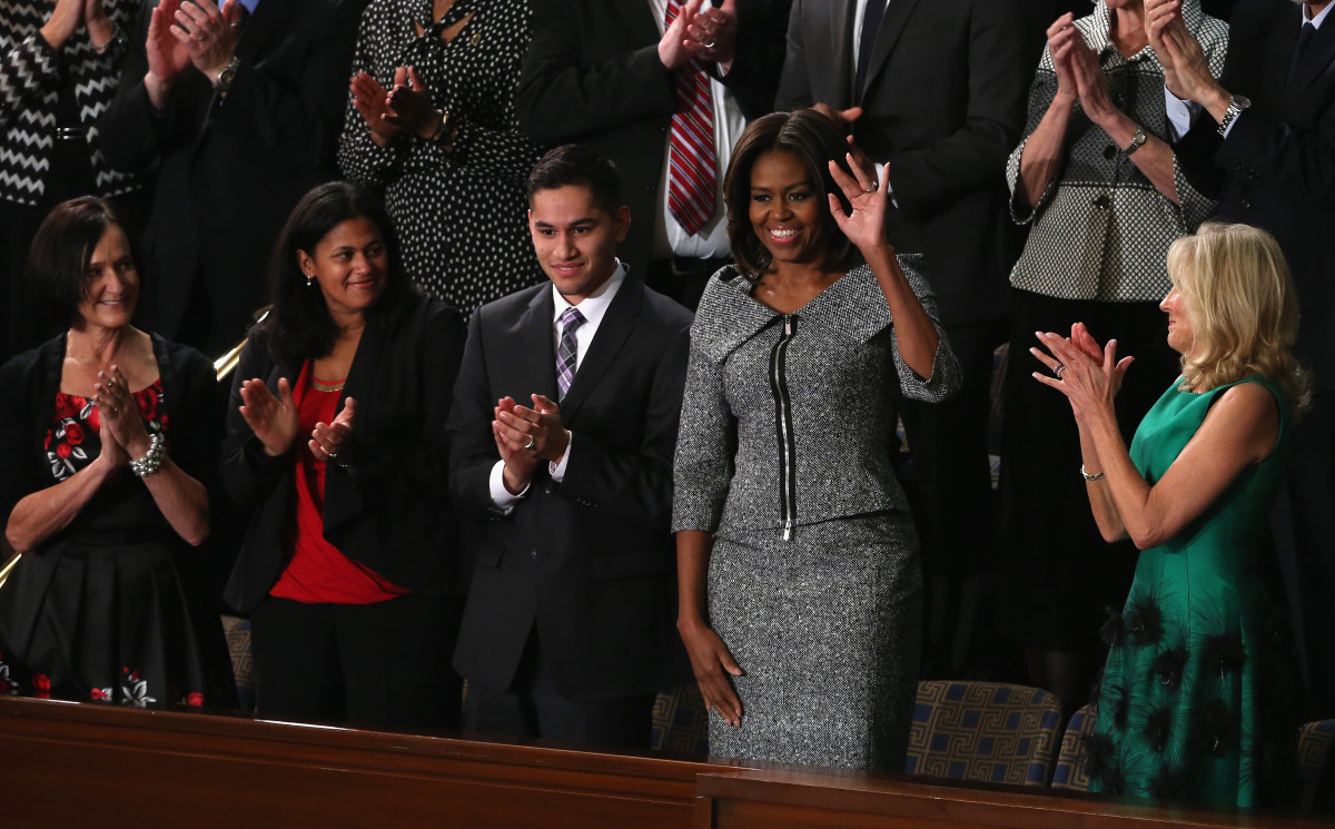 First Lady Michelle Obama waves during President Barack Obama's State of the Union speech. Photo: Mark Wilson/Getty Images