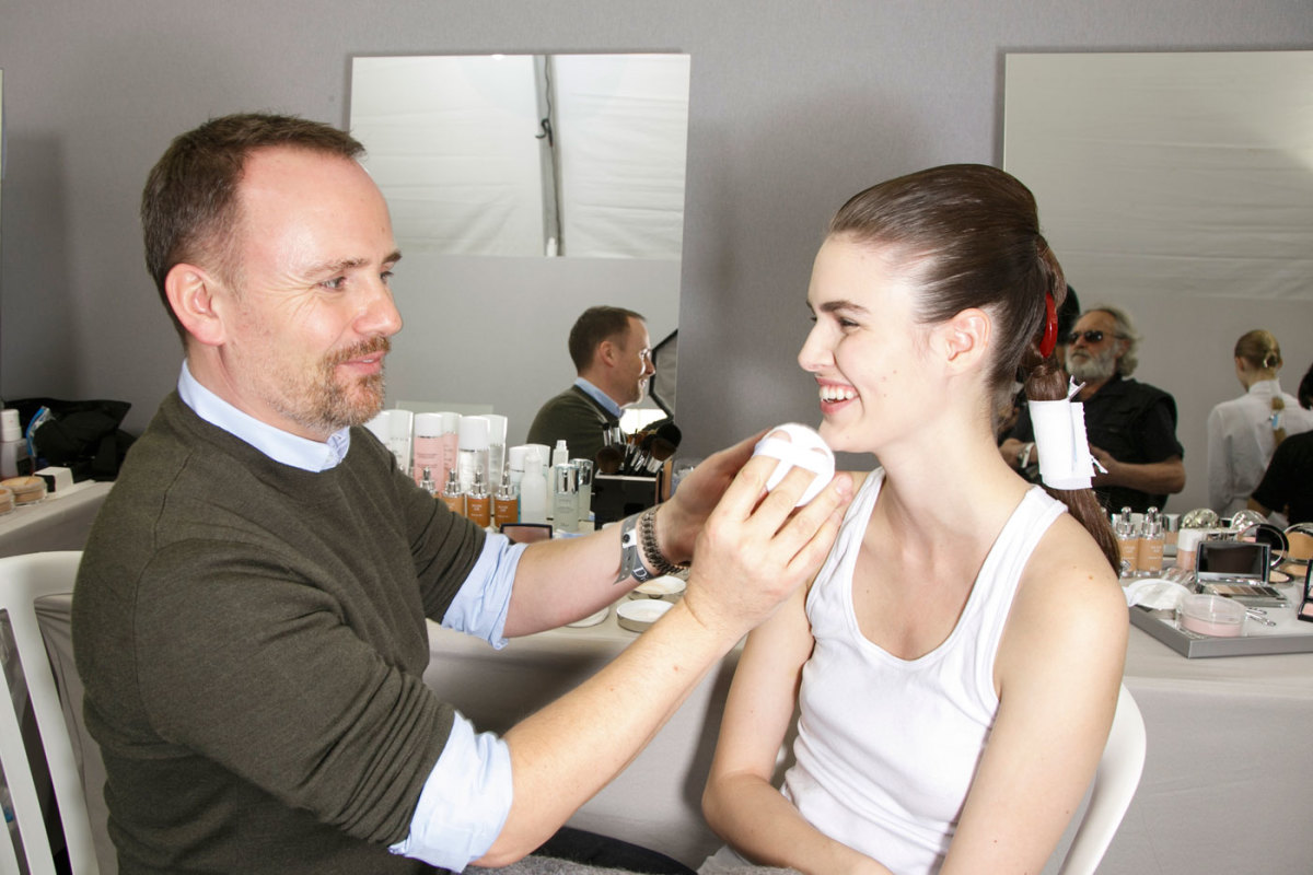 Dior makeup artist Peter Philips at work backstage. Photo: Imaxtree