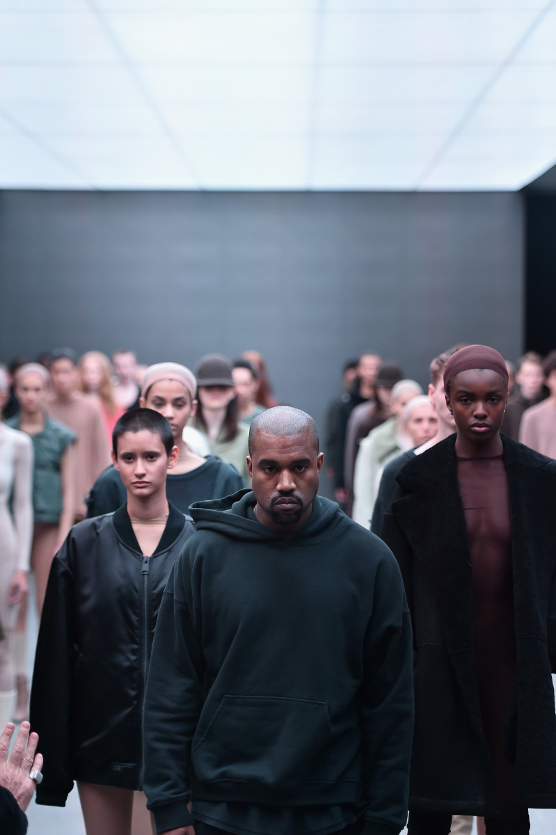 Kanye West takes a bow at his Yeezy presentation for Adidas on Thursday. Photo: Getty Images/Theo Wargo