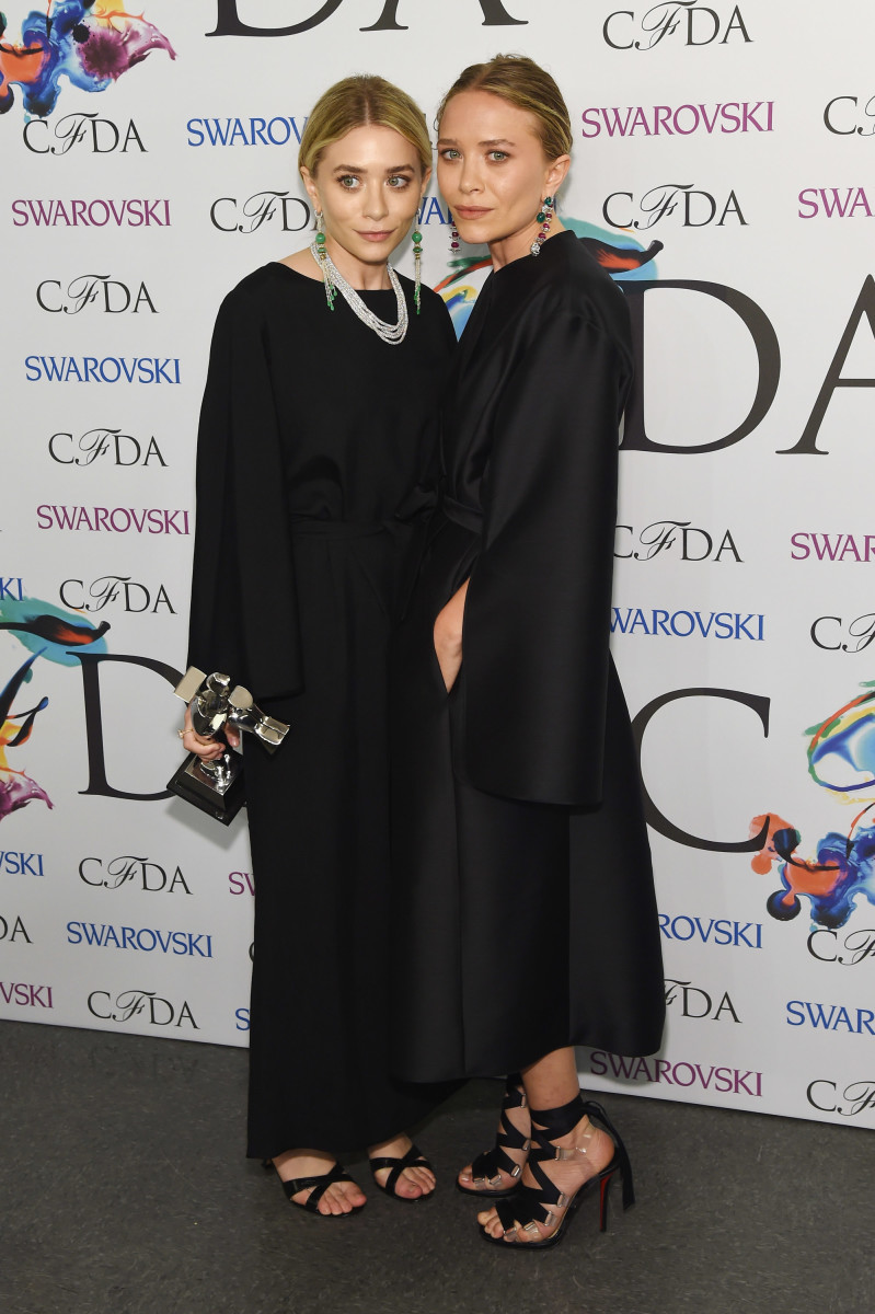 Ashley and Mary-Kate Olsen with their 2014 CFDA Award. Photo: Larry Busacca/Getty Images