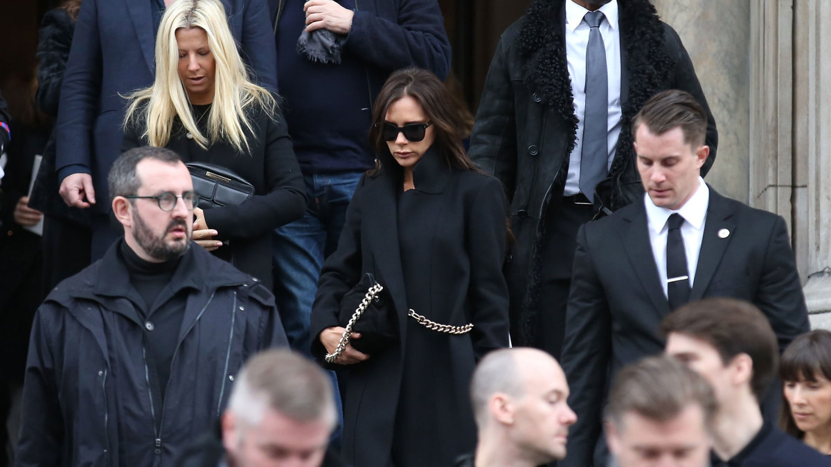Victoria Beckham exits the service. Photo: Tim P. Whitby/Getty Images