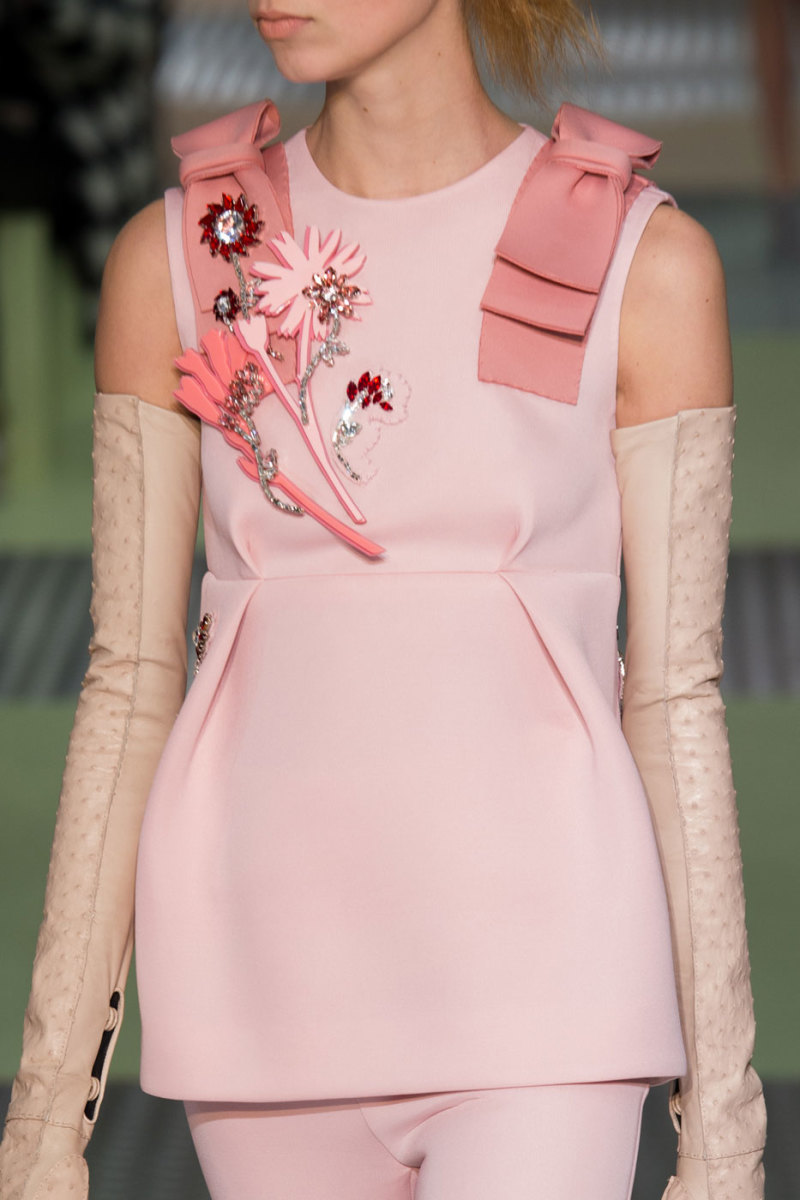 Brooches at Prada's fall 2015 runway presentation. Photo: Imaxtree.