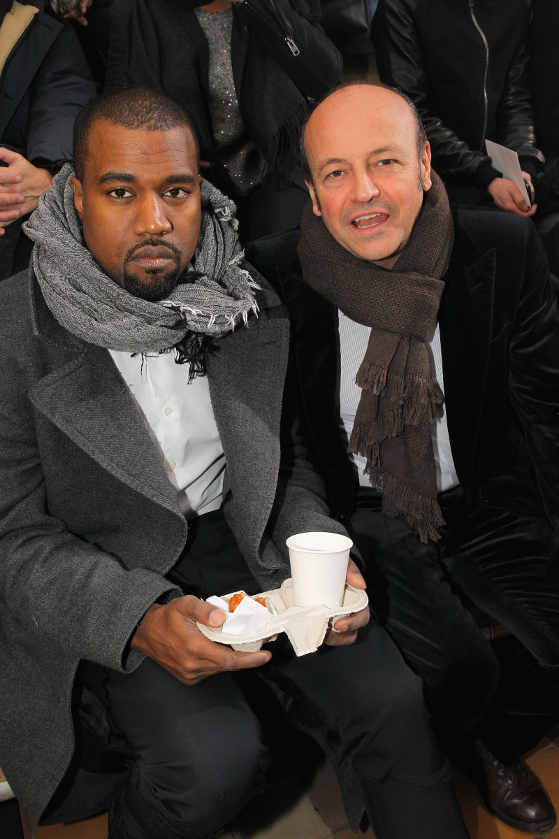 Thierry Andretta with Kanye West, having a snack front row at Lanvin in 2013. Photo: Bertrand Rindoff Petroff/Getty Images