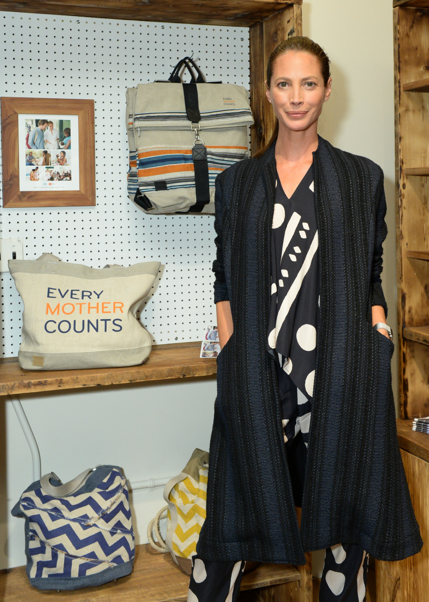 The supermodel next to the TOMS x Every Mother Counts collaboration tote and backpack. Photo: BFA