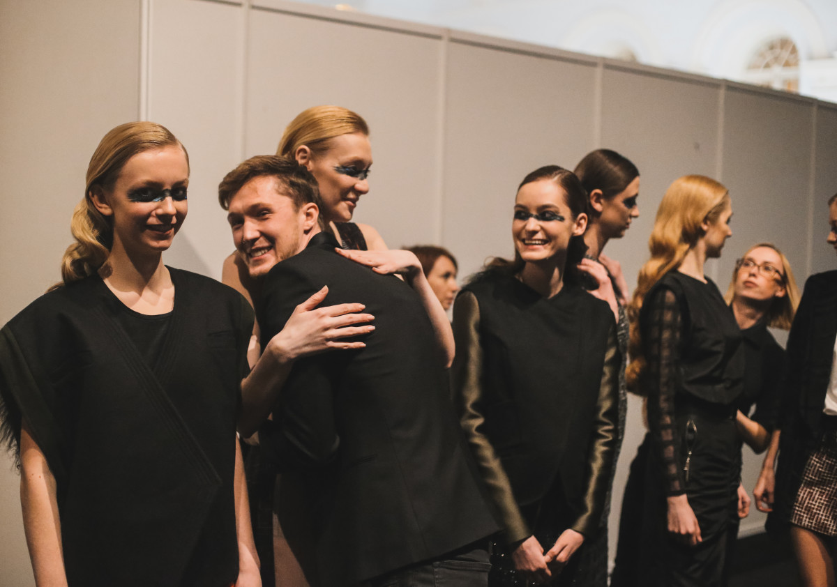 Saint-Tokyo designer Yriy Pitenin with models before his fall runway show. Photo: Mercedes Benz Fashion Week Russia