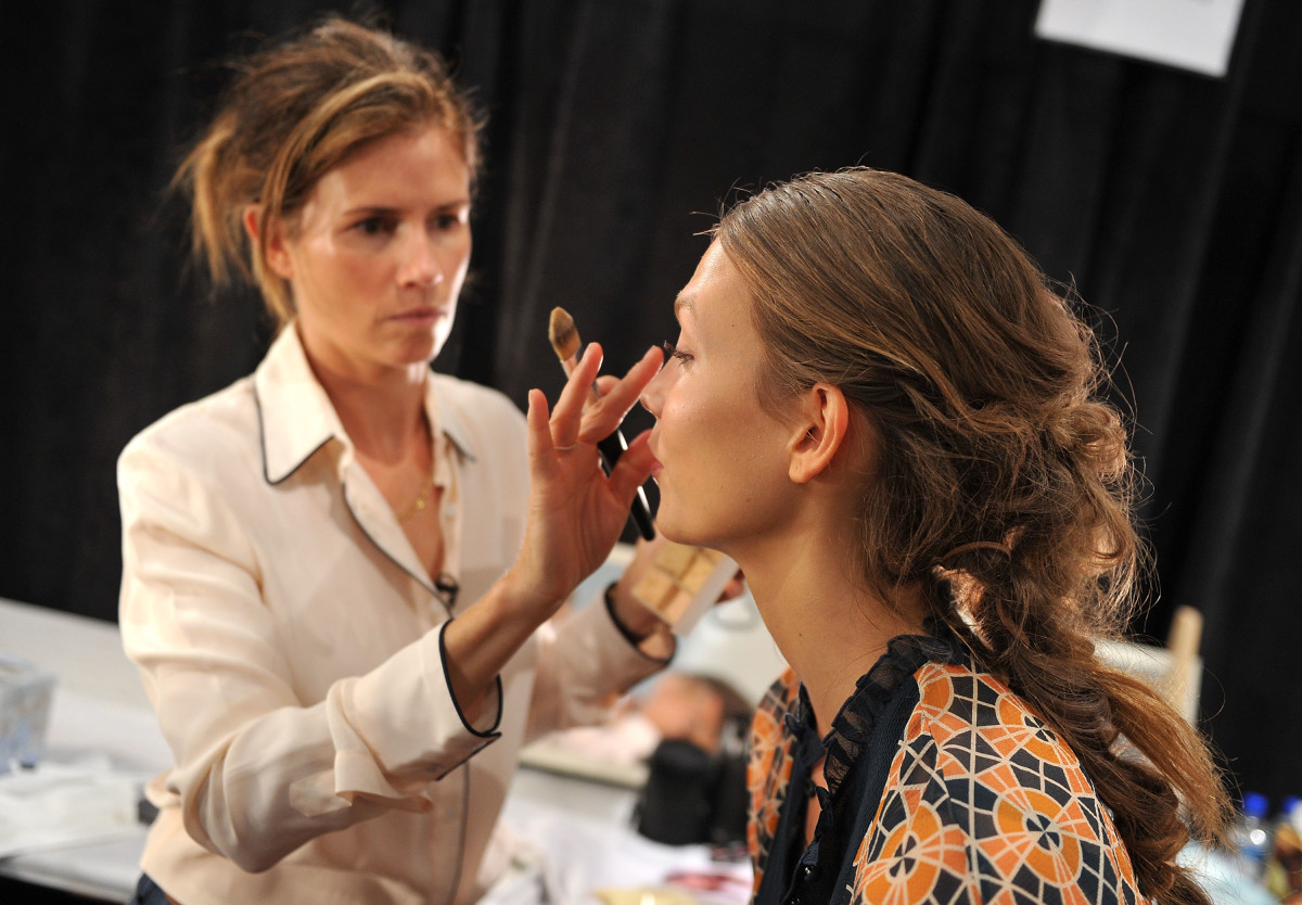 Westman with Karlie Kloss backstage at the spring 2012 J. Mendel show. Photo: Stephen Lovekin/Getty