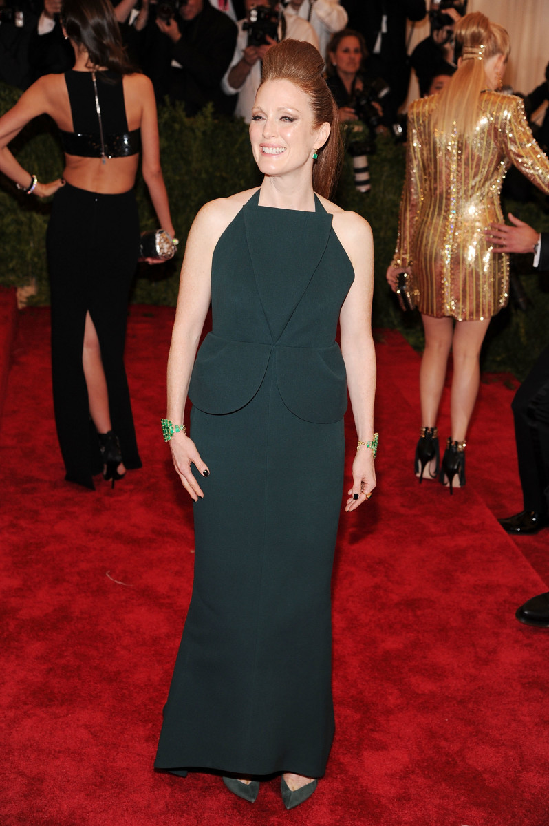 Julianne Moore at the Met Gala in 2013 wearing Irene Neuwirth's emerald cuffs. Photo: Jamie McCarthy/Getty Images