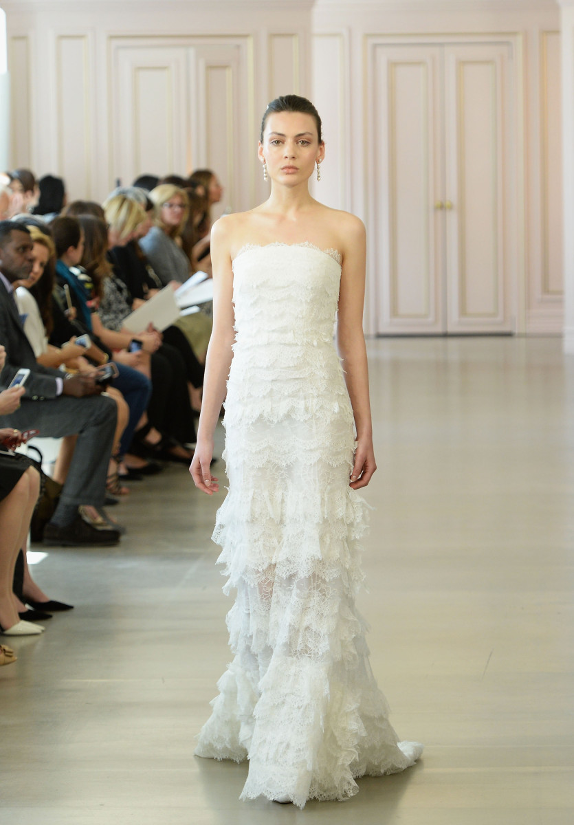 An ivory scalloped lace trumpet gown from the Oscar de la Renta spring 2016 bridal collection.  Slaven Vlasic/Getty Images