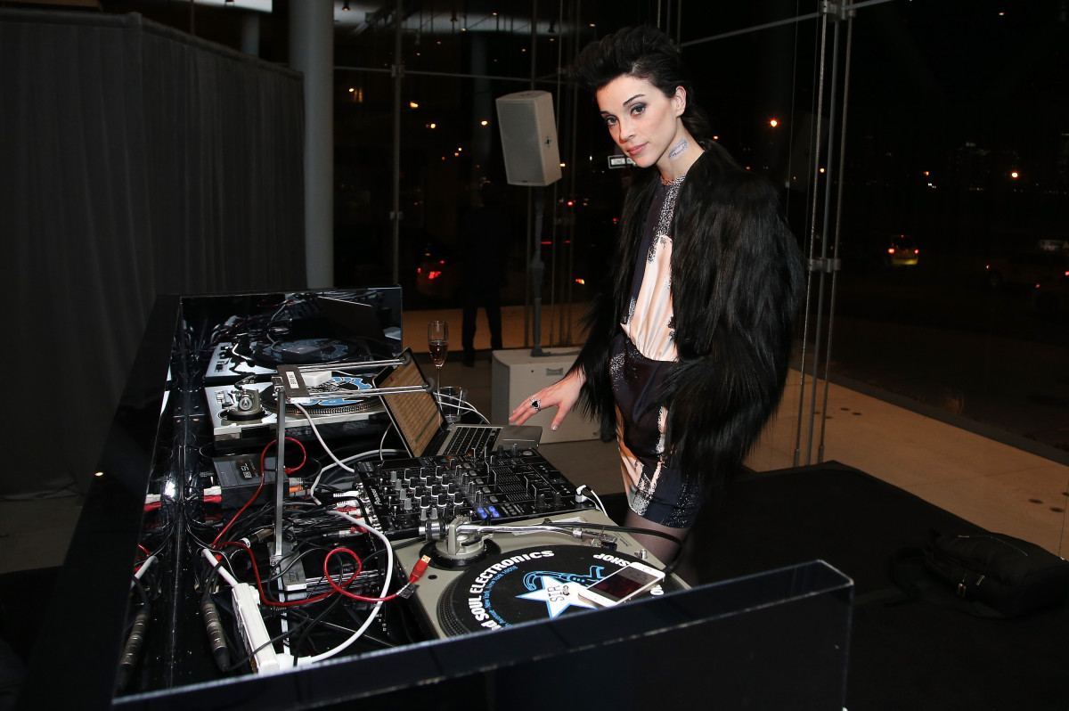 St. Vincent in a Max Mara dress and her own jacket. Photo: Neilson Barnard/Getty Images