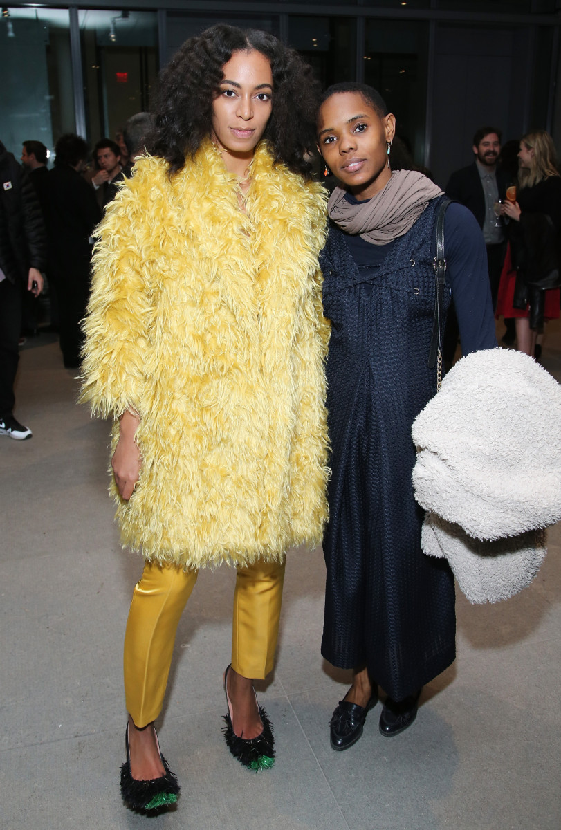 Solange Knowles in Katie Ermilio pants with friend at the Max Mara Whitney party. Photo: Neilson Barnard/Getty Images