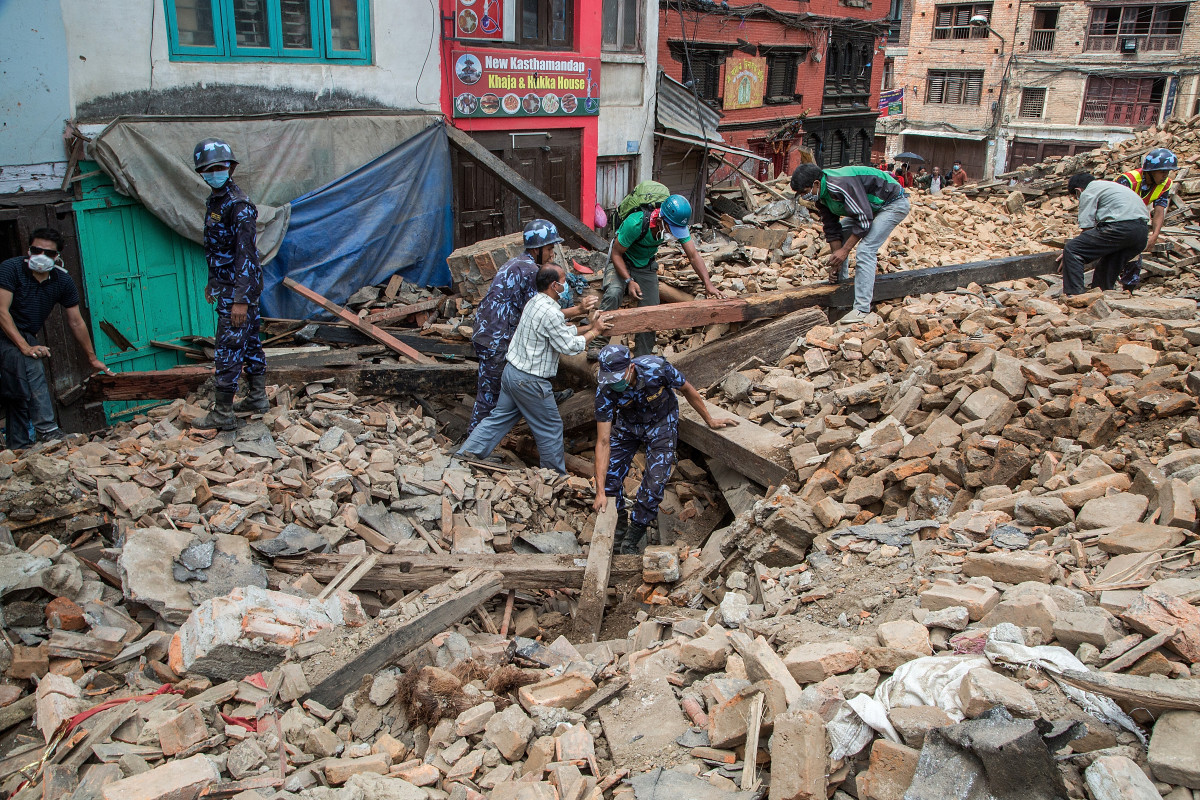 Workers mine through the rubble following Saturday's earthquake in Nepal. Photo: Omar Havana/Getty Images