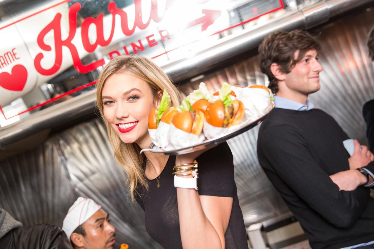 Karlie Kloss serving burgers to guests. Photo: Benjamin Lozovsky/BFA.com