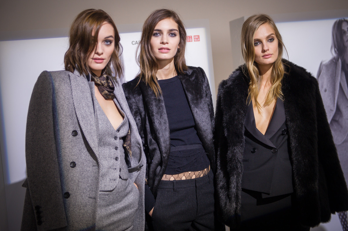 Models looking very Carine Roitfeld in the Carine Roitfeld x Uniqlo collection. Photo: Francois Durand/Getty Images