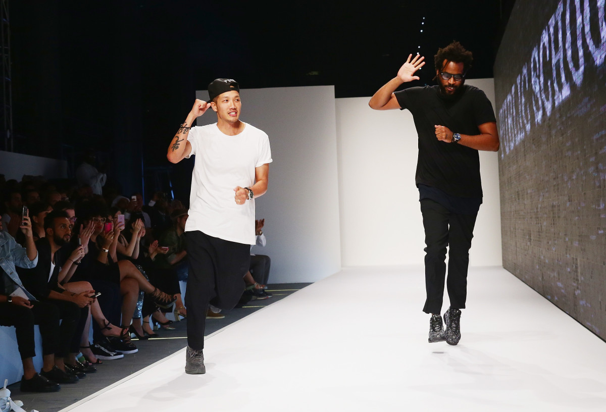 Dao-Yi Chow and Maxwell Osborne take to the runway in Dubai. Photo: Cadillac