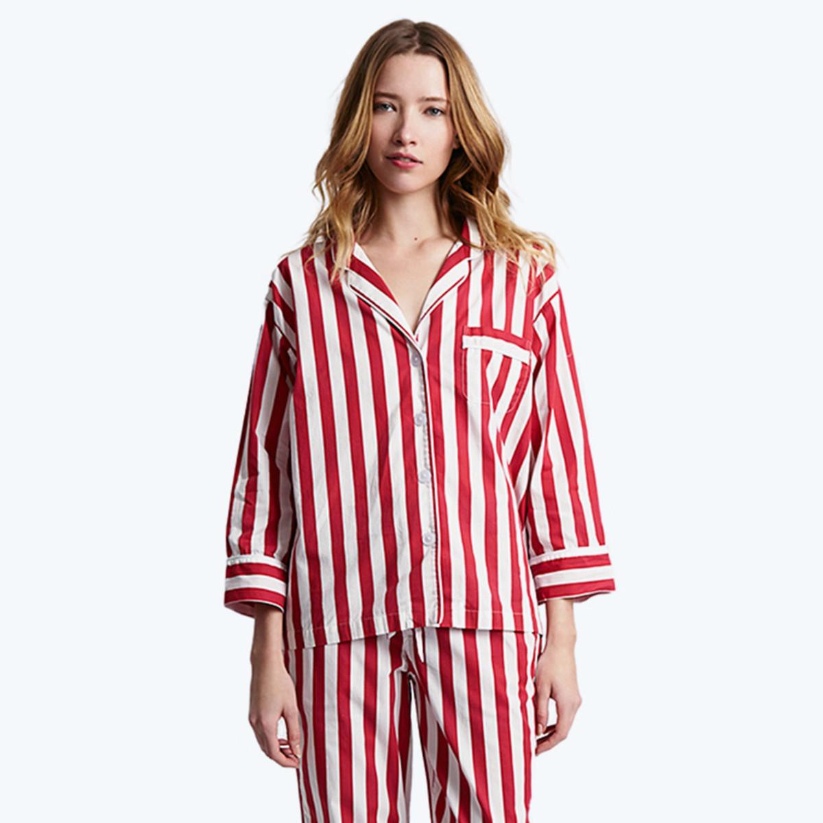 Sleepy Jones tent stripe pajama shirt, $148, available at Sleepy Jones; Sleepy Jones tent stripe pajama pant, $128, available at Sleepy Jones.