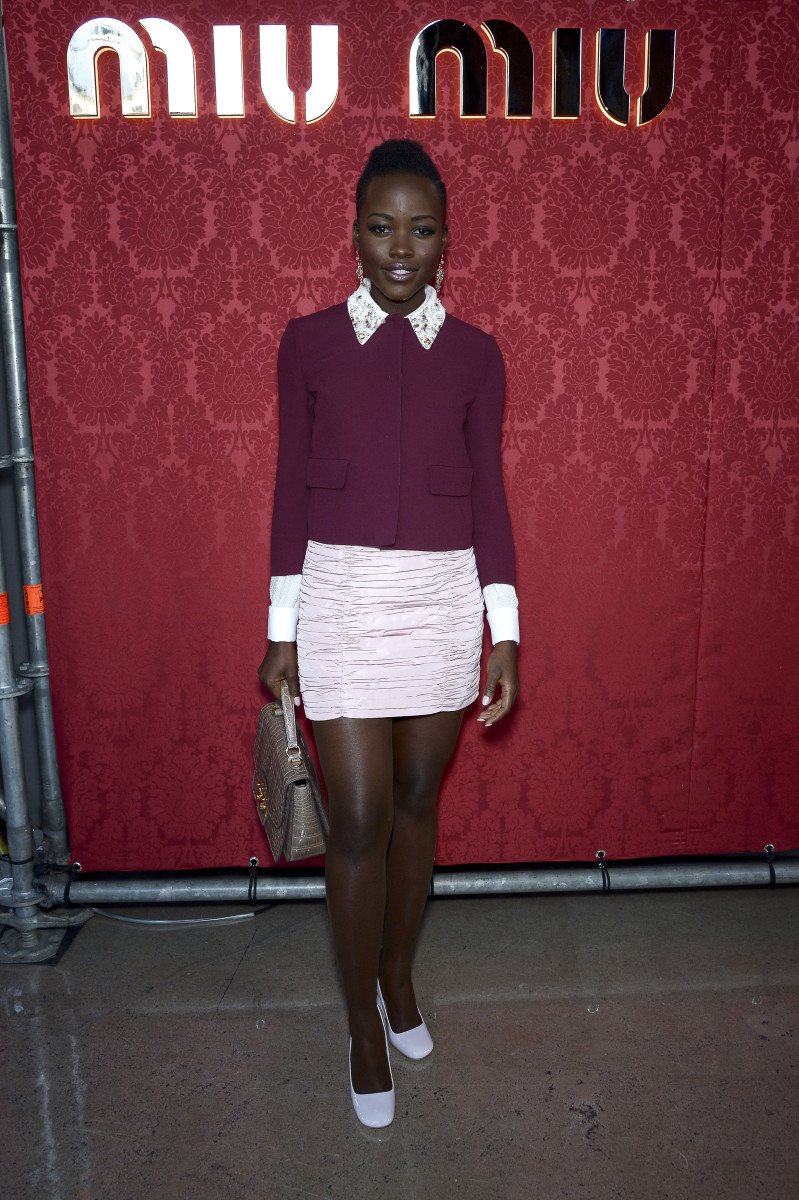 Lupita is selling this whole Miu Miu outfit (minus accessories). Photo: Dominique Charriau/WireImage