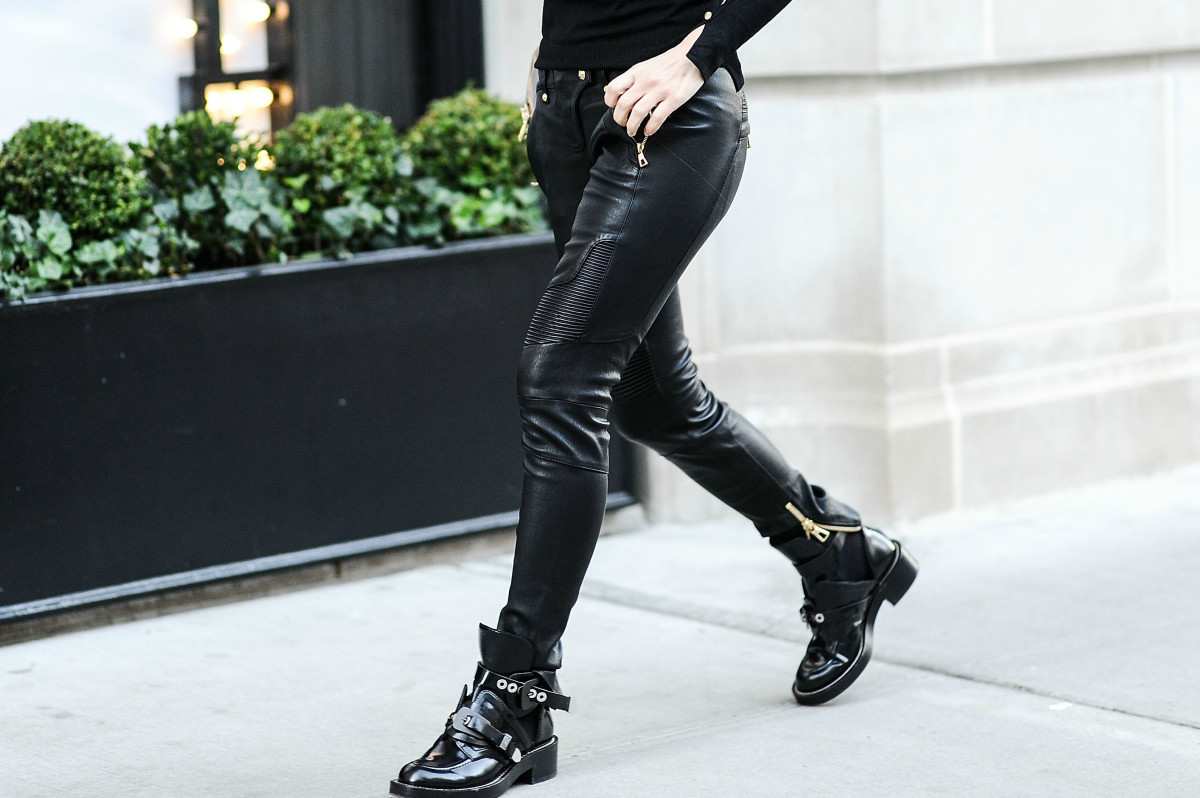 A woman wearing Balmain x H&M leather biker pants in Nov. 2015 in New York. Photo: Daniel Zuchnik/Getty Images