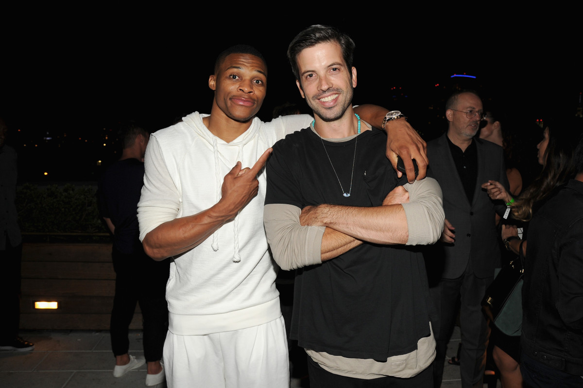 Welch, at right, with Russell Westbrook at a 'GQ' party. Photo: Bryan Bedder/Getty Images