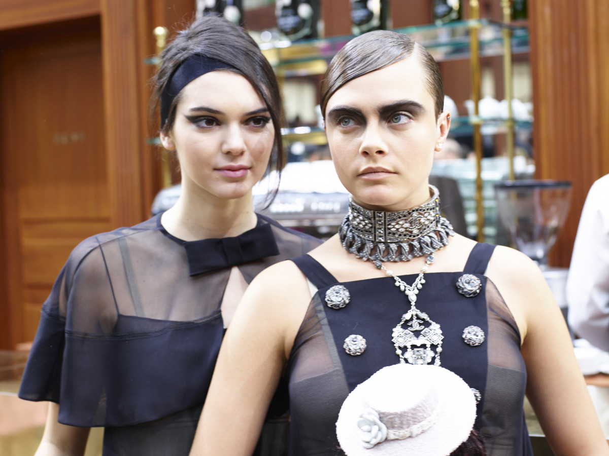 Kendall Jenner and Cara Delevingne at Chanel's fall 2015 show in March. Photo: Antonello Trio/Getty Images