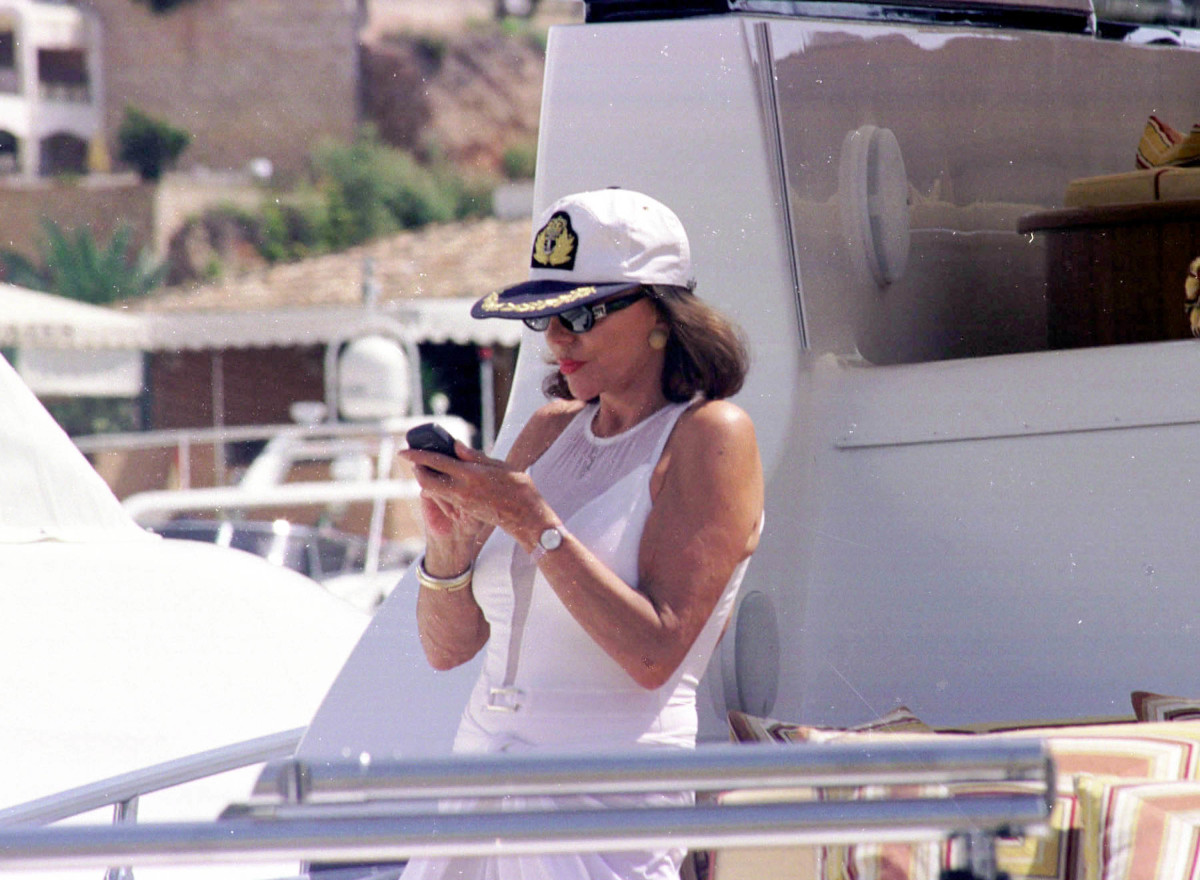 Actress Joan Collins aboard Valentino's yacht in Mallorca in the summer of 2001. Photo: Roberto Fernandez/Interactive Press/Getty Images