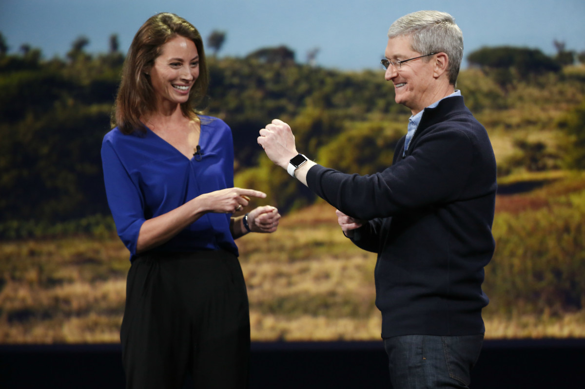 Christy Turlington Burns and Tim Cook demoing the Apple Watch. Photo: Stephen Lam/Getty Images