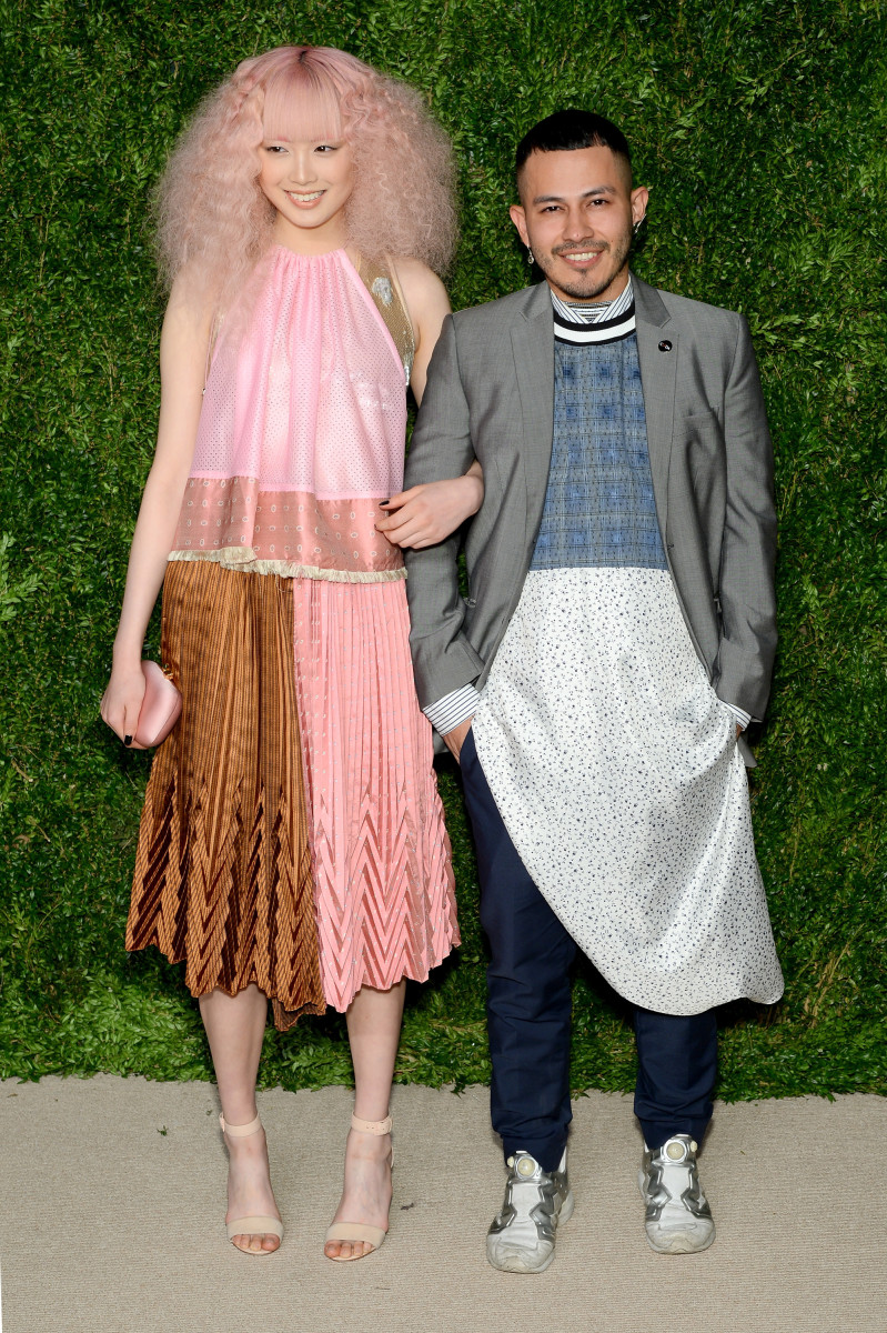 Fernanda Ly wearing Gypsy Sport, with Rio Uribe. Photo: Andrew Toth/Getty Images