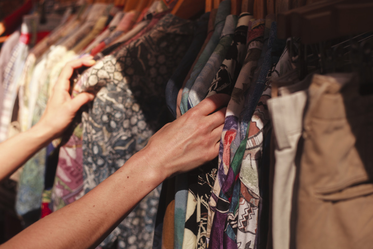 Sifting through those budget-friendly thrift finds. Photo: iStockPhoto