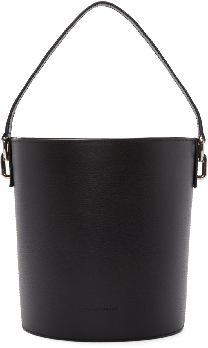 J.W. Anderson black leather bucket bag, $1,215, available at Ssense.