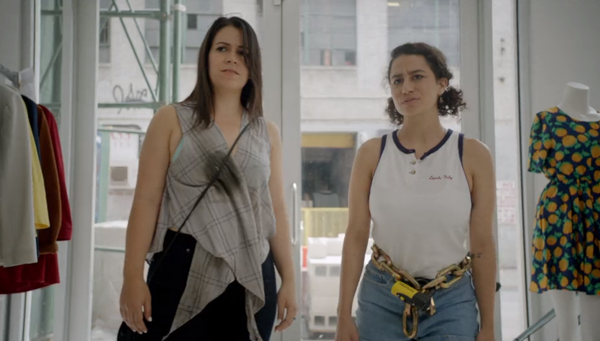 Abbi and Ilana hit up a sample sale to find a gallery-appropriate outfit. Screengrab: Comedy Central