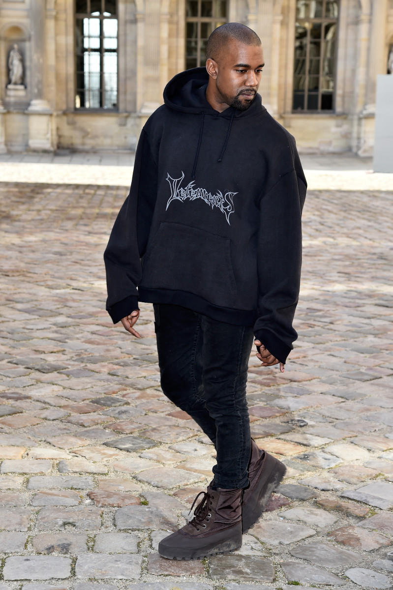 Kanye West wearing Vetements outside of the Christian Dior fall 2015 show in Paris. Photo: Pascal Le Segretain/Getty Images