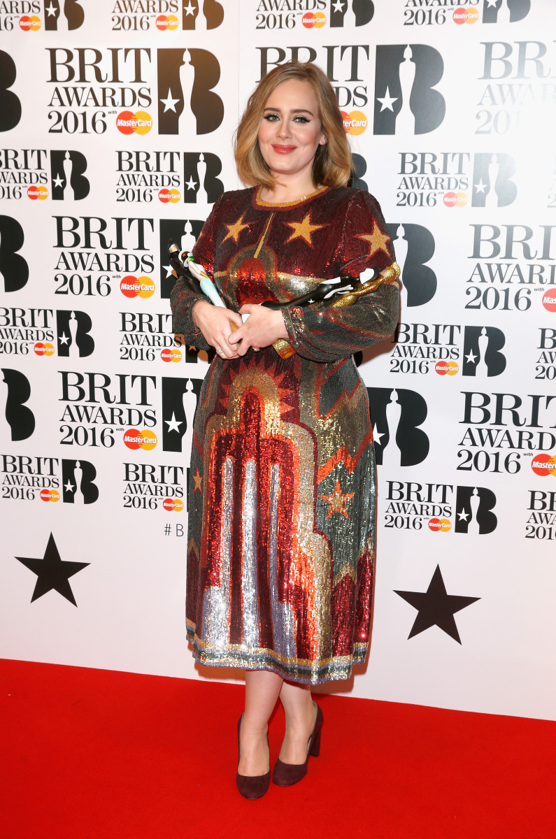 Adele toting her two statuettes in the winners room at the 2016 Brit Awards on Wednesday in London. Photo: Luca Teuchmann/Getty Images