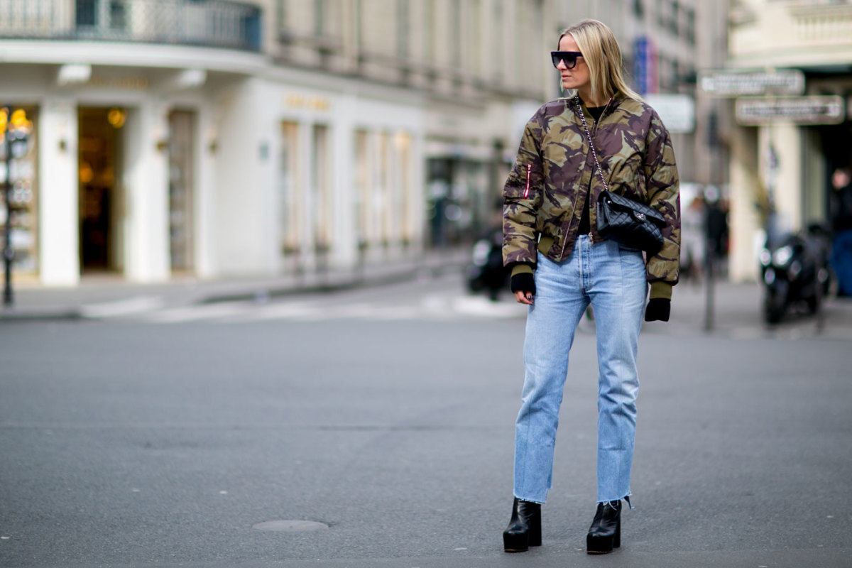 A showgoer in Vetements jeans at Paris Fashion Week. Photo: Imaxtree