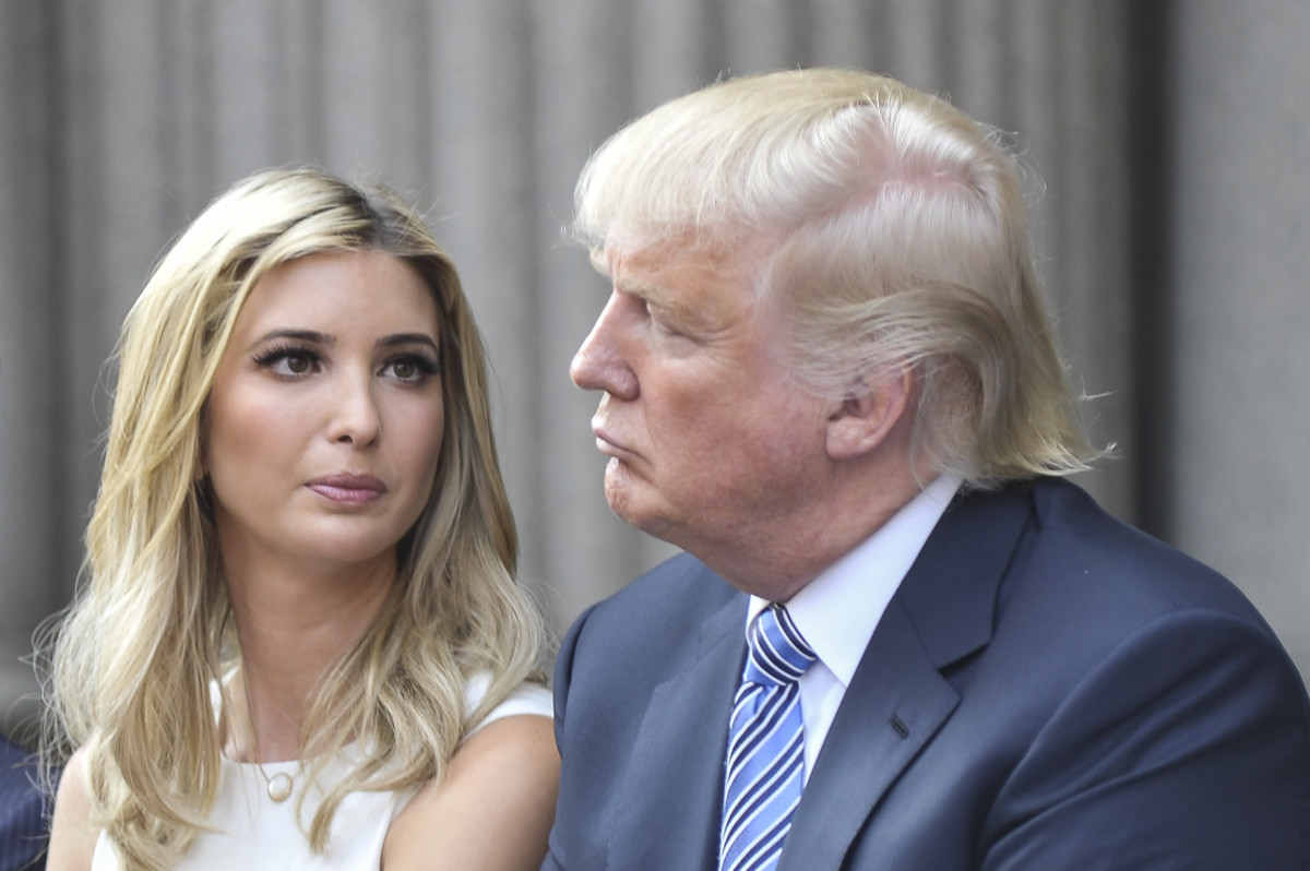 """""""Dad, seriously. What is going on with your hair?"""" -- Ivanka Trump (not really, but I imagine she's thinking it), here with her father in 2014. (Photo: Kris Connor/Getty Images)"""